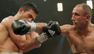 Unbeaten middleweight world champion Arthur Abraham (30-0, 24 KOs) retained his IBF title with a thrilling tenth-round technical knockout over German-based Turk Mahir Oral (25-2-2, 7 KOs) on Saturday night at the Max Schmeling Halle in Berlin, Germany. Abraham scored five knockdowns in all, including three in round ten before Oral's corner stopped the fight.